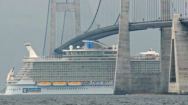 Royal Caribbean's Allure of the Seas passes under Denmark's Storebaelt Bridge on Saturday.