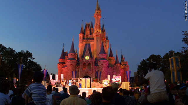 Visitors watch a show in front of Cinderella Castle at Walt Disney World's Magic Kingdom in Orlando, Florida.
