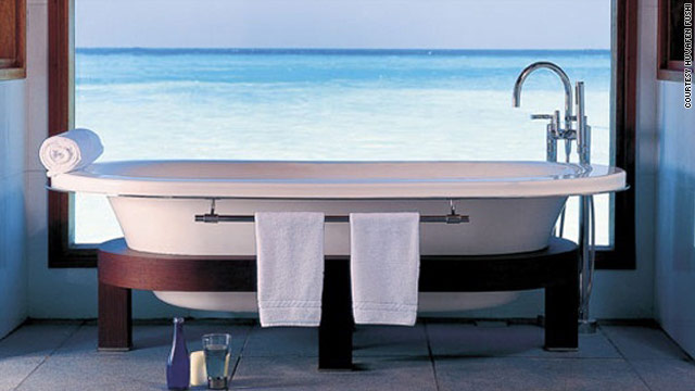 Enjoy the priceless view as you soak in this bathtub at the Huvafen Fushi resort in the Maldives.