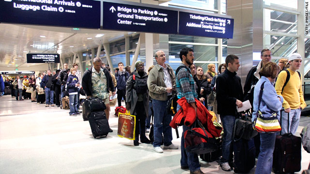 Passengers stand in line to go through a security screening at the Detroit Metropolitan Airport during the holidays last year.