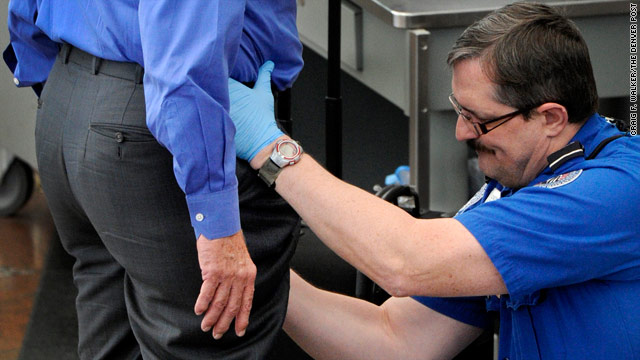 A man receives a pat-down at Denver International Airport in Denver, Colorado.