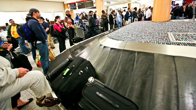 Passengers at Hartsfield-Jackson Atlanta International Airport wait at the baggage claim on Friday.