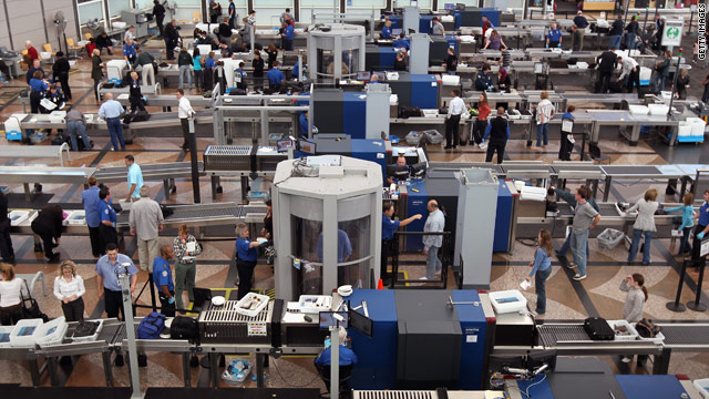 Passengers go through full-body scanners and metal detectors at Denver International Airport on Monday.