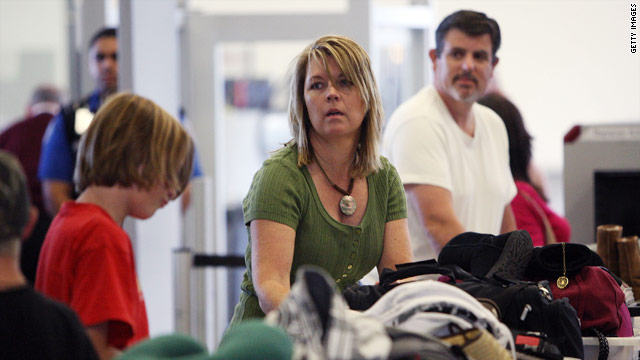Air travelers pass through security at Los Angeles International Airport in Los Angeles, California, on Monday.