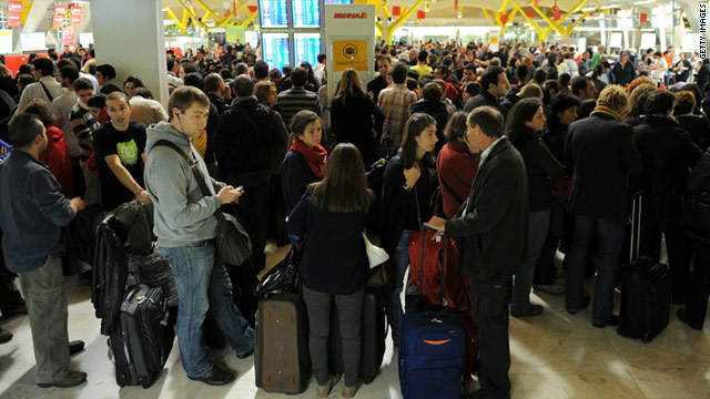Passengers wait as Barajas airport is crippled by a sudden strike on December 3, 2010 in Madrid, Spain.