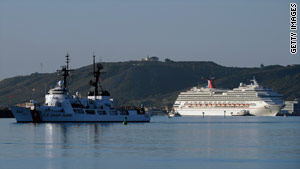 The Carnival Splendor, right, had to be towed to shore in San Diego, California.