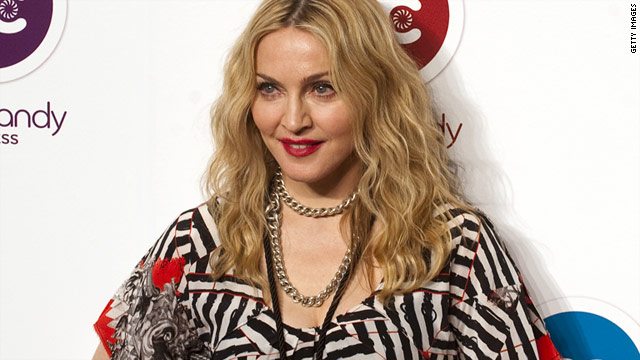 Madonna was let off a Virgin Atlantic flight two hours before any other passengers, according to reports in the Daily Mail.