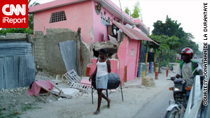 A damaged house in Haiti. Many Americans from Haiti are anxiously awaiting word from relatives.