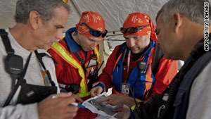 Members of U.S. and Icelandic rescue teams review maps this week in Port-au-Prince, Haiti.
