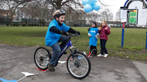 Charlie Simpson rode his bike five miles to raise money for UNICEF.