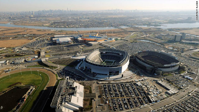 Giants Stadium, right, is coming down, with New Meadowlands, left, taking its place. Some say the Hoffa legend needs to go, too.