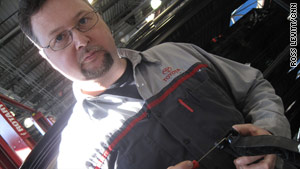 Mike Gaige of Parkway Toyota in Englewood Cliffs, New Jersey, shows where parts will go to fix Toyota accelerators.