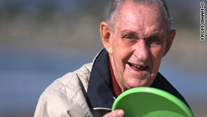 "Walter Fredrick ""Fred"" Morrison holds a Frisbee in a photo from Wham-O's Web site. He invented the flying disc."