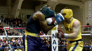 Midshipman 1st Class Michael Anthony Steadman, in blue, trades punches with Midshipman Angelo Loreno.