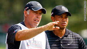 Steve Williams, shown with Tiger Woods in September, says he's disappointed in his friend, but supportive.