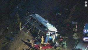 First responders work in and around the crashed bus early Friday along I-10 south of Phoenix, Arizona.