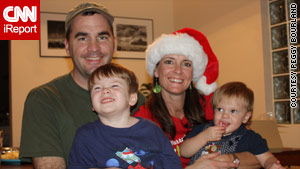 Ken and Peggy Bourland hold sons Charley and Andrew. Ken Bourland died in the January earthquake in Haiti.