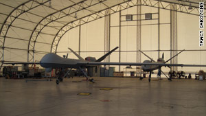 Predator B unmanned vehicles wait to be deployed inside a hangar at Fort Huachuca, Arizona.