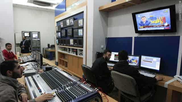 Al-Aqsa Television employees work inside the station's studio in Gaza City on Thursday.