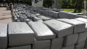 A Mexican soldier guards 12 tons of marijuana in Tijuana, Baja California state, Mexico, in February.