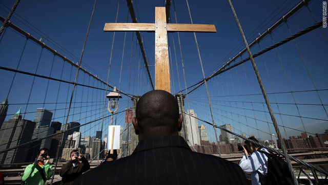 The Way of the Cross procession crosses the Brooklyn Bridge in New York to celebrate Good Friday on Friday.