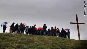 Church members hold a Good Friday cross walk after an outdoor service near Bath, England.