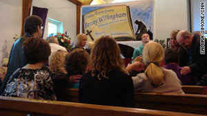 Loved ones of Benny Willingham comfort one another during his funeral Friday in Mullens, West Virginia.