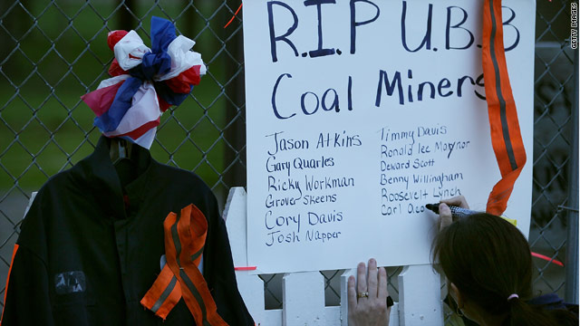 Mickie Green writes the names of 29 fallen coal miners on a small memorial in Whitesville, West Virginia.