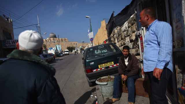 "Palestinian men gather near the ""City of David"" Jewish settlement on March 2 in the East Jerusalem neighborhood of Silwan."