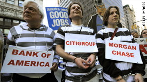 Protesters march in New York on Thursday, calling for banks to be held accountable for their role in the recession.