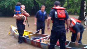 Neelyann Sheucraft and daughter Lowell Ann were rescued from floodwaters that burst into their home.