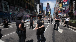 Police block off a section of Broadway in Times Square on Friday after a suspicious package was found.