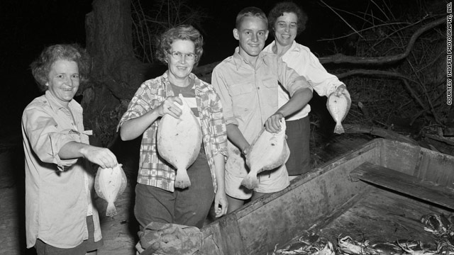 "A rare phenomenon in Mobile Bay sends thousands of fish and crab ashore. Locals, like these in 1950, go crazy over ""jubilees."""