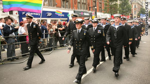Military personnel take part in a Gay Pride parade in London. A British officer says integrating gays was not a problem.