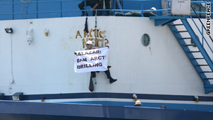 Greenpeace activists smeared messages on the vessel with raw crude from the Gulf Coast oil spill.