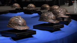 The service featured 11 bronze hard hats representing the 11 victims of the explosion.