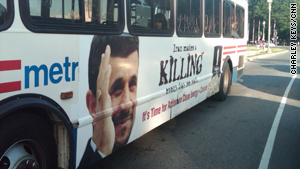 "The ad on the side of buses reads ""Iran makes a KILLING every day we wait."""