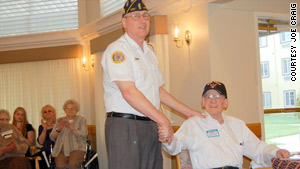 American Legion official Joe Craig returns a lost wallet missing for nearly 70 years to Bob Bell Sr.