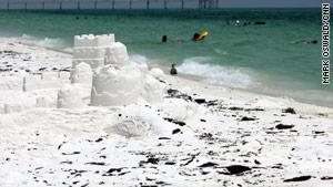 Splotches of tar from the Gulf Coast oil spill dot the beach at Destin, Florida.