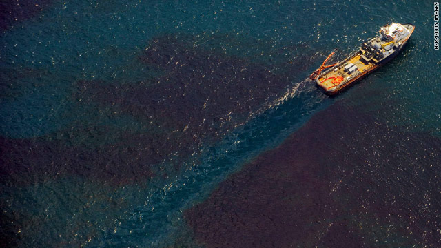A ship passes through oil-covered water off the Louisiana coast on Saturday.