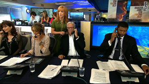 Kathy Griffin listens to Ted Danson take a call during the telethon Monday evening.