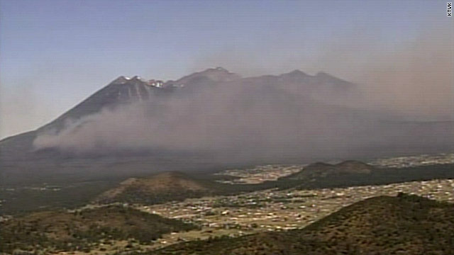 Smoke from a huge wildfire covers mountaintops near Flagstaff, Arizona, on Tuesday.