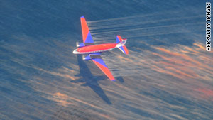The crew of a Basler BT-67 fixed wing aircraft releases oil dispersant off the shore of Louisiana in May.