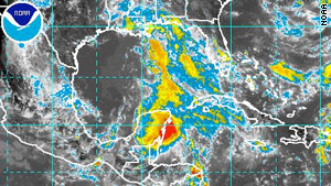 The low-pressure system is over the northern Yucatan Peninsula and the south-central Gulf of Mexico.