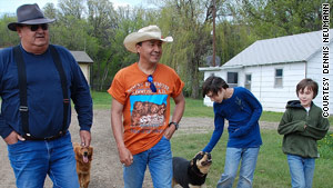 George Keepseagle, left, walks with his family in North Dakota. The case against the USDA is named for him.