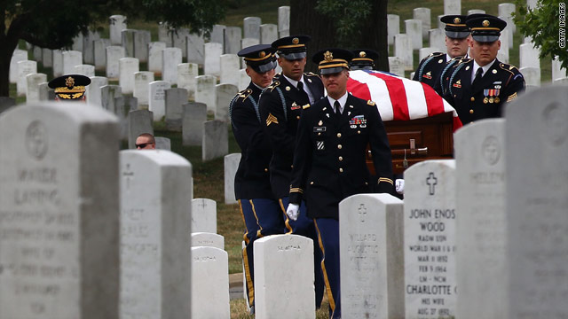 An Army honor guard carries the casket of World War I casualty Pvt. Thomas Costello at Arlington National Cemetery on Monday.