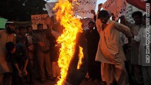 Pakistani Muslims burn an effigy of cartoonist Molly Norris during a protest in May in Karachi, Pakistan.