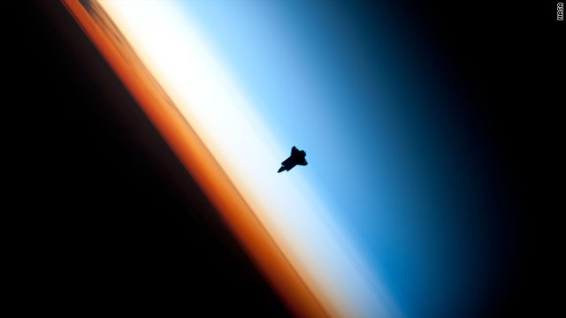 Shuttle Endeavour is silhouetted against Earth's atmosphere as it prepares to dock with the space station in February.