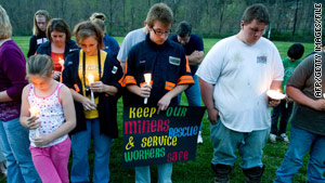 Friends and family members hold a candlelight vigil during the West Virginia coal mine disaster in April.
