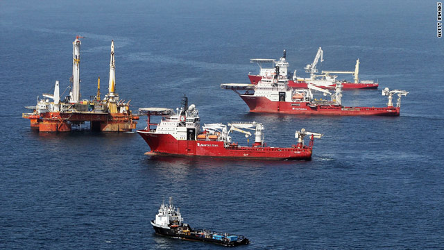 Ships assist collection of oil Friday near the source of the Deepwater Horizon leak before leaving to avoid a storm.